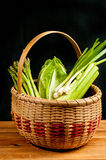 Vintage woven reed basket of organic, green vegetable Royalty Free Stock Photos