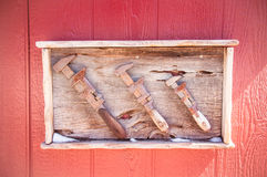 Vintage Wrench. Old tools framed in red wood Stock Image