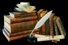 Vintage writing instruments and old books Stock Photography
