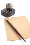 Vintage Writing Set. Old fashioned pen, ink-pot and piece of paper isolated over white background Stock Photos