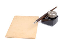 Vintage Writing Set. Old fashioned pen, ink-pot and piece of paper isolated over white background Stock Image