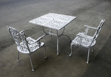 Vintage wrought iron garden table and chairs Royalty Free Stock Image