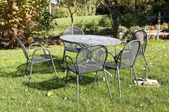 Vintage wrought iron table and chairs for picnic in Italian garden. Stock Image