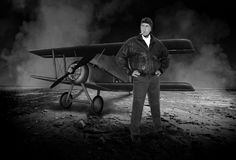 Vintage WWI Ace Fighter Pilot. Vintage or retro WWI ace fighter pilot. The World War I soldier stands like a hero in front of his biplane Royalty Free Stock Photos