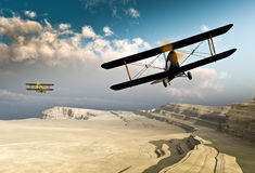 Vintage WWI Biplanes flying over Canyon Royalty Free Stock Images