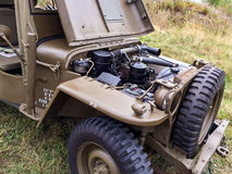 Vintage WWII military vehicle engine. Engine compartment of a well preserved military WWII Jeep Royalty Free Stock Images