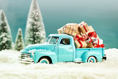 Vintage xmas toys. Handing out of presents on noel evening stock image
