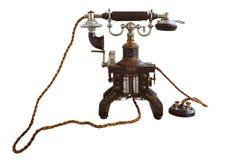 Vintage y aislante clásico del teléfono en blanco imagenes de archivo
