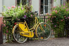 Vintage yellow bicycle in the street