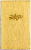 Vintage Yellow Book XXL. Vintage book cover bound in yellow cloth with a gilded illustration of a flower bouquet. Detail, XXL Stock Photos