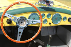 Vintage yellow British sportscar interior Stock Photos
