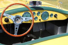 Vintage yellow British sportscar interior Stock Photos
