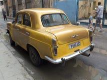 Vintage yellow car in Havana. Stock Images