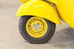 Vintage Yellow Car Wheel; Classic Vehicles. Old car parks in the garage Stock Photo