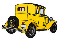 Vintage yellow coupe Royalty Free Stock Photos