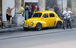 Vintage yellow 4cv parked in Havana. Stock Photo