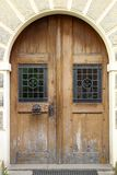 The vintage yellow design wooden front door of an old house.  stock photos