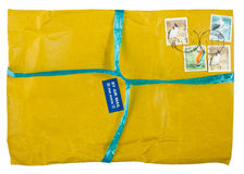 Vintage yellow envelope with stamps Royalty Free Stock Images