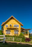 Vintage yellow European style house on hill Stock Images