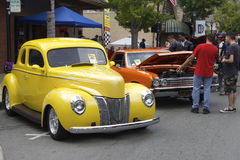 Vintage Yellow Ford and red Chevrolet Stock Photos