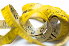 Vintage yellow measuring tape Stock Image
