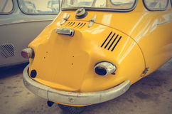 Vintage yellow old car (Filtered image processed vintage effect). Vintage yellow old car (Filtered image processed vintage effect, Retro Style Royalty Free Stock Photo