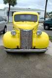 Vintage yellow pickup truck Stock Images