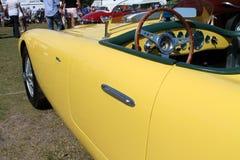 Vintage yellow racing car side Stock Photography