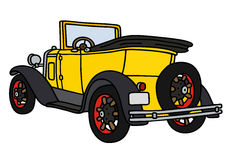 Vintage yellow roadster Stock Images