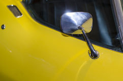 Vintage yellow sports car. Close up detail of a vintage yellow sports car Stock Photo