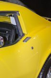 Vintage yellow sports car. Close up detail of a vintage yellow sports car Royalty Free Stock Image