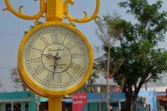 Vintage yellow street clock. Left frame. Stock Photos