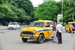 Vintage Yellow Taxi Cab on the Street. In Kolkata, India Stock Photos