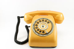Vintage yellow telephone Stock Images