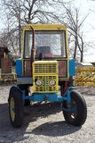 Vintage yellow tractor stock photography
