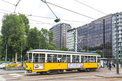 Vintage yellow tram on the street in of Milan, Italy Royalty Free Stock Images