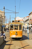 Vintage yellow tram on the street of Porto Royalty Free Stock Photography