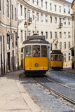 Vintage yellow tramway in Lisbon, Portugal. Bright tram on neutral background building. Tram edit up Royalty Free Stock Photos
