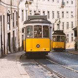 Vintage yellow tramway in Lisbon, Portugal. Bright tram on neutral background building. Tram edit up Stock Image