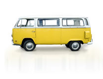 Vintage yellow van. A yellow volkswagen retro van.  The bus is on a white background with slight shadow.  Side of van is ready for copy Royalty Free Stock Photography