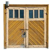 Vintage yellow wooden garage doors with glass windows royalty free stock photo