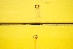 Vintage yellow wooden panels with rusty nails Royalty Free Stock Photo