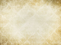 Vintage yellowed paper background. Aged yellowed paper with old-fashioned patterns. Vintage paper texture for the design Royalty Free Stock Images