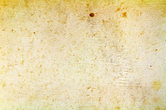 Vintage yellowed paper texture with brown spots. Abstract background Stock Photography