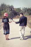 Vintage young couple in love touching hands outside Royalty Free Stock Photos