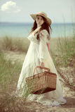 Vintage young lady going for picnic Royalty Free Stock Images