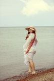 Vintage young lady by the sea Royalty Free Stock Photography