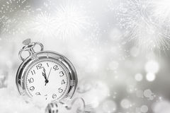 Vintageclock with fireworks and holiday lights Stock Photo