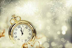 Vintageclock with fireworks and holiday lights. New Year's at midnight - Old clock with fireworks and holiday lights Royalty Free Stock Photos