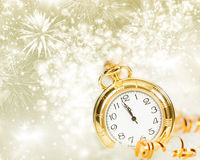 Vintageclock with fireworks and holiday lights. New Year's at midnight - Old clock with fireworks and holiday lights Royalty Free Stock Photo